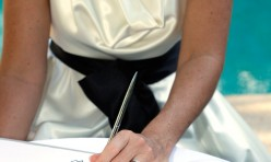Noosa Poolside Wedding - Signing the registrar